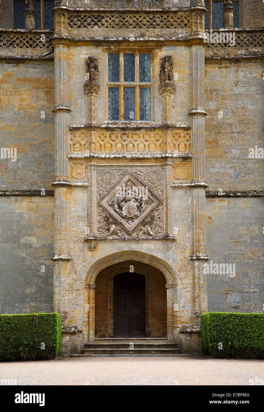 Entrance porch and coat of arms at Montacute House an Elizabethan Ham stone manor in Somerset Stock Photo
