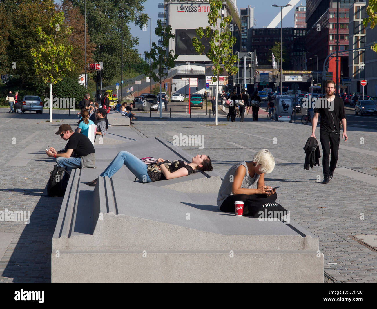 Concrete Street Furniture With Young People Relaxing In The Sun And Stock Photo Royalty Free