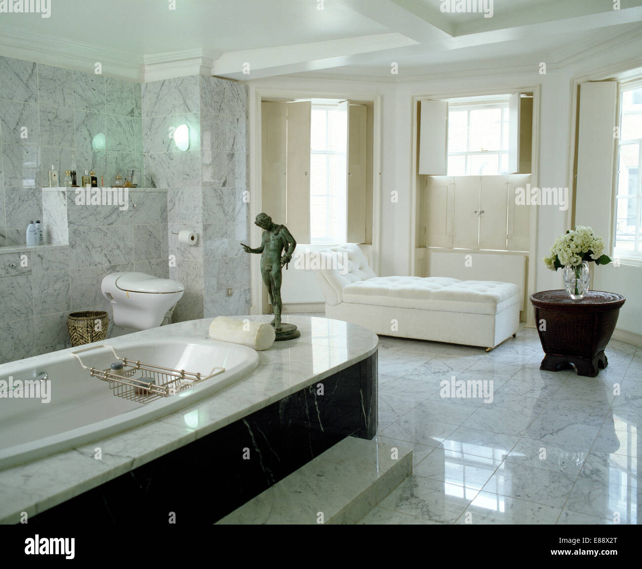 Grey And White Panelled Bathroom: Bronze Classical Statue On Marble Panelled Bath In Pale