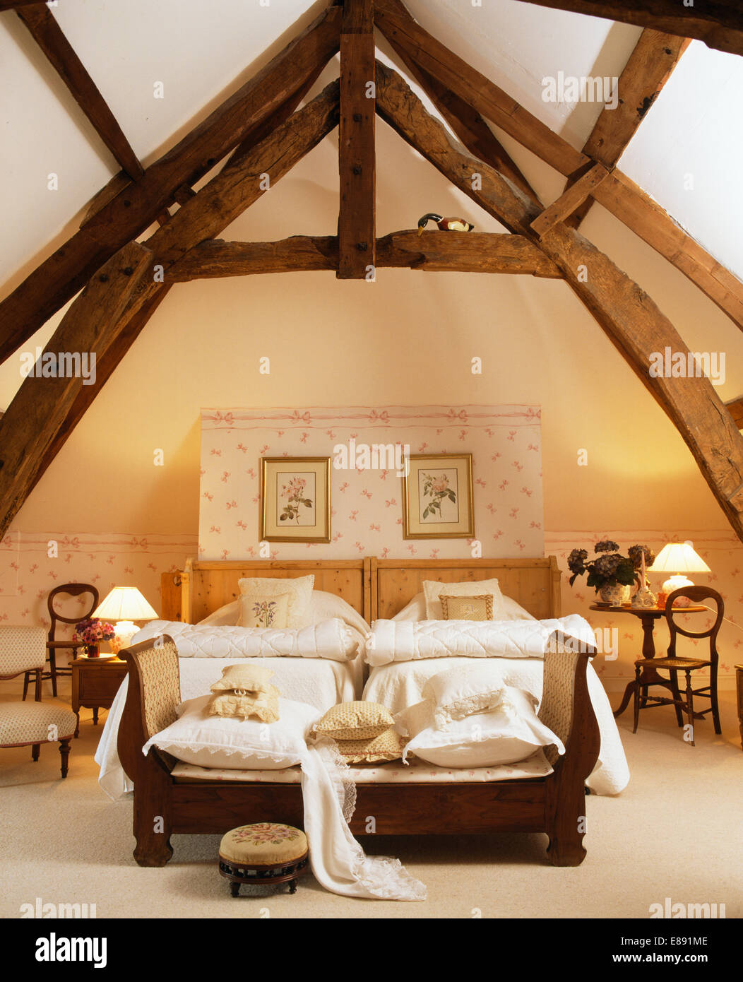 High, beamed apex ceiling in French country bedroom with ...