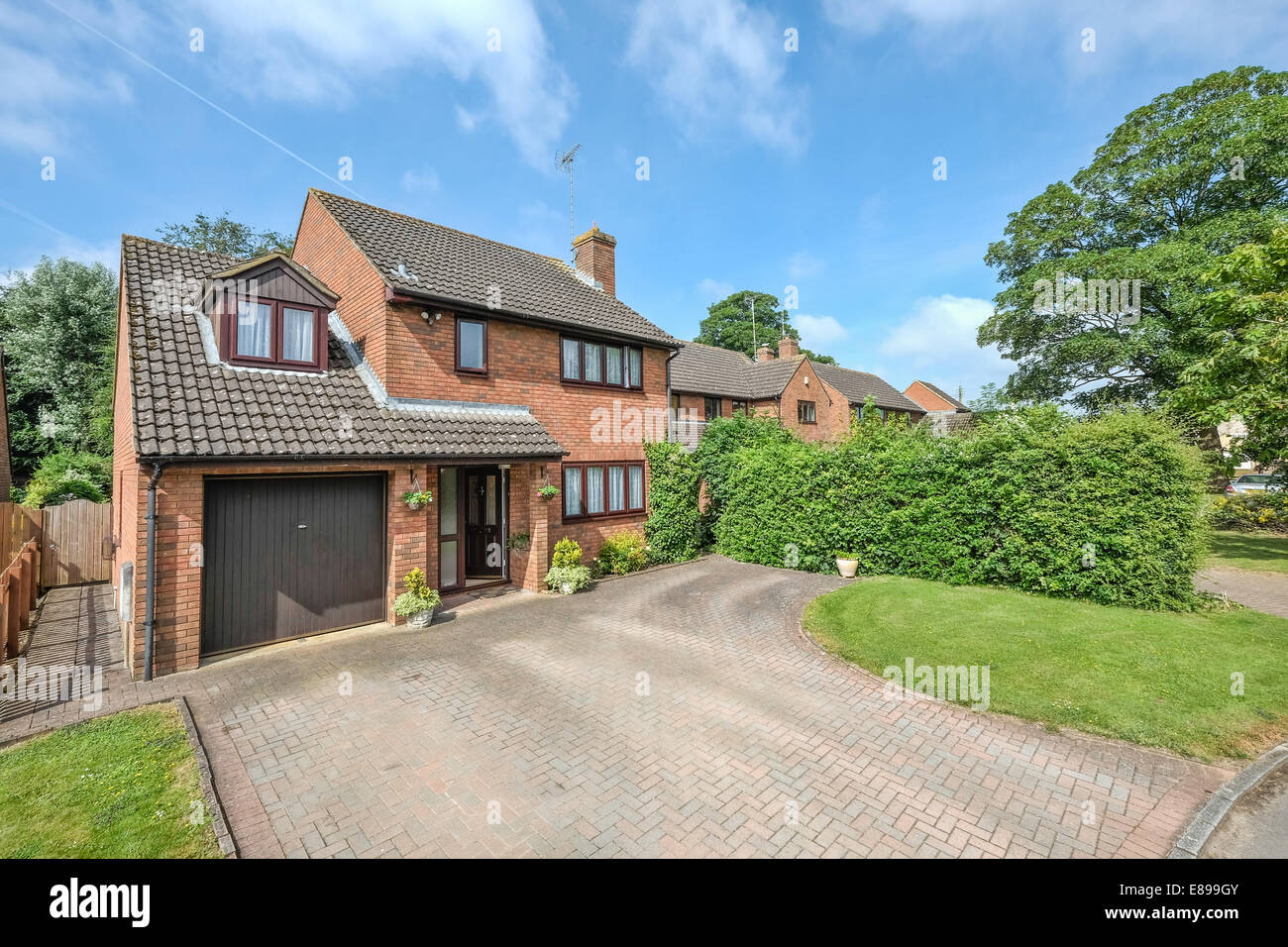 A Typical Contemporary British Red Brick Detached Family