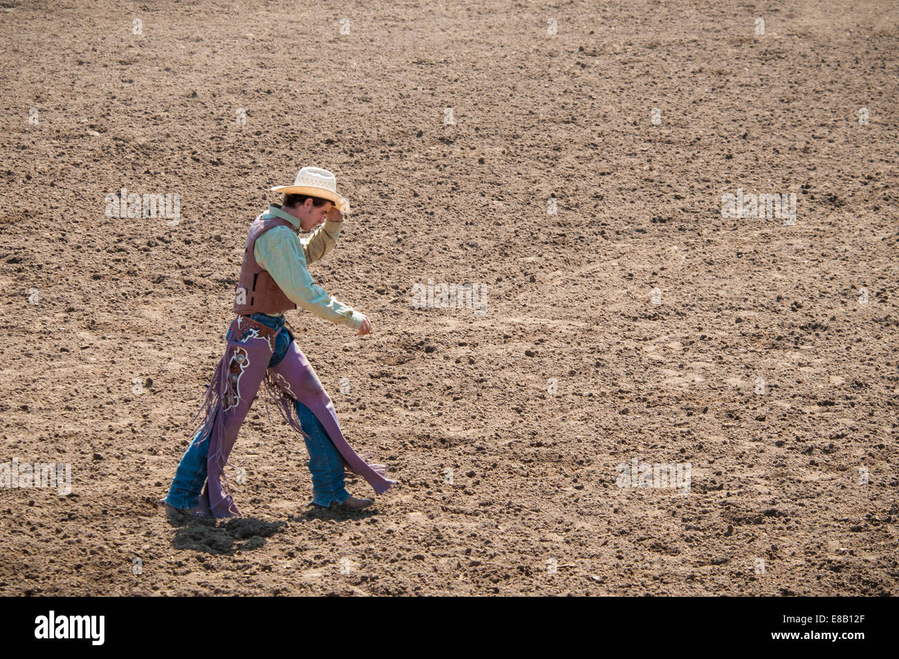 rodeo-cowboy-walking-across-the-dirt-are