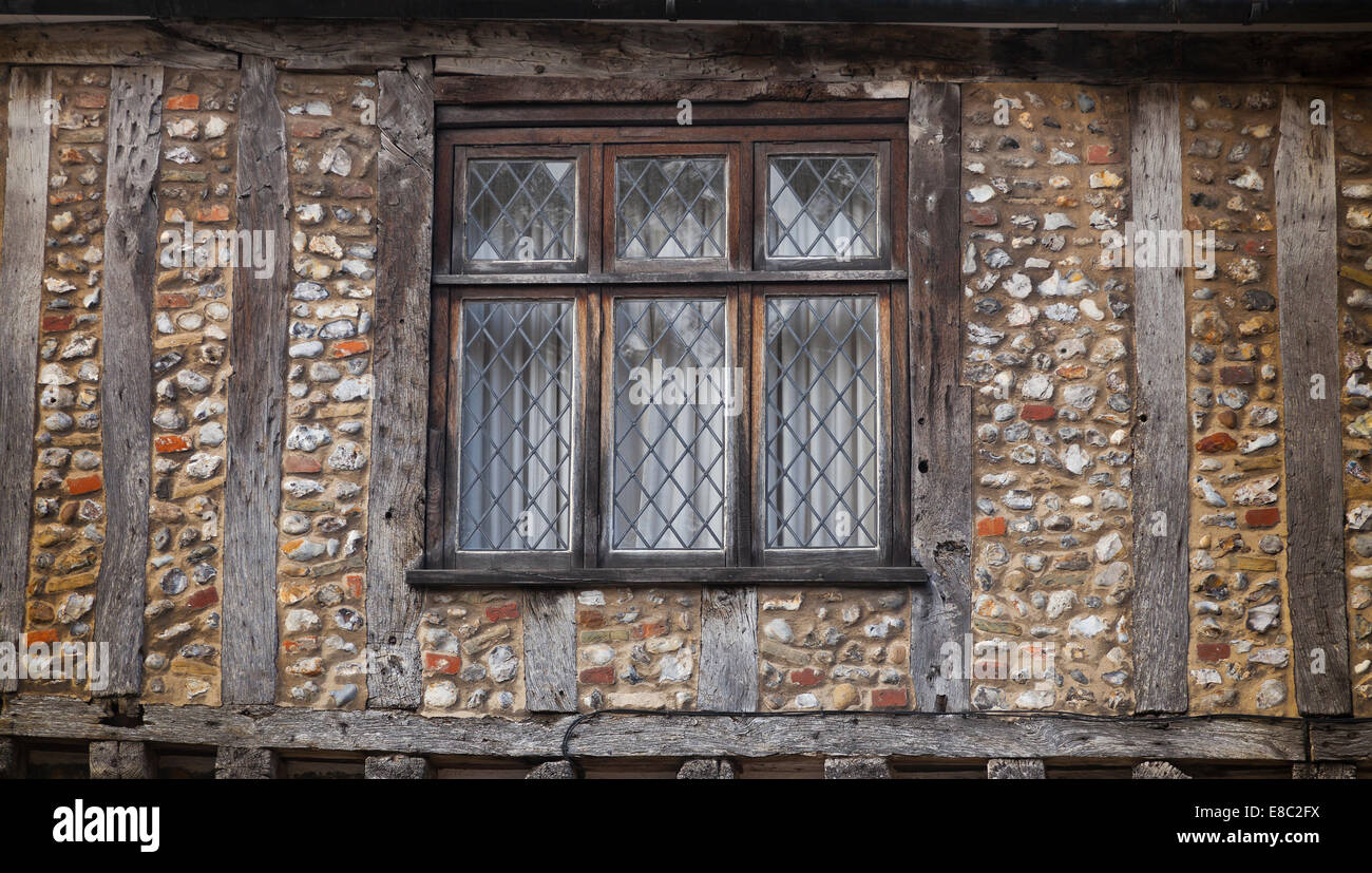 Wood framed Tudor style house, flint walls, lead windows ...