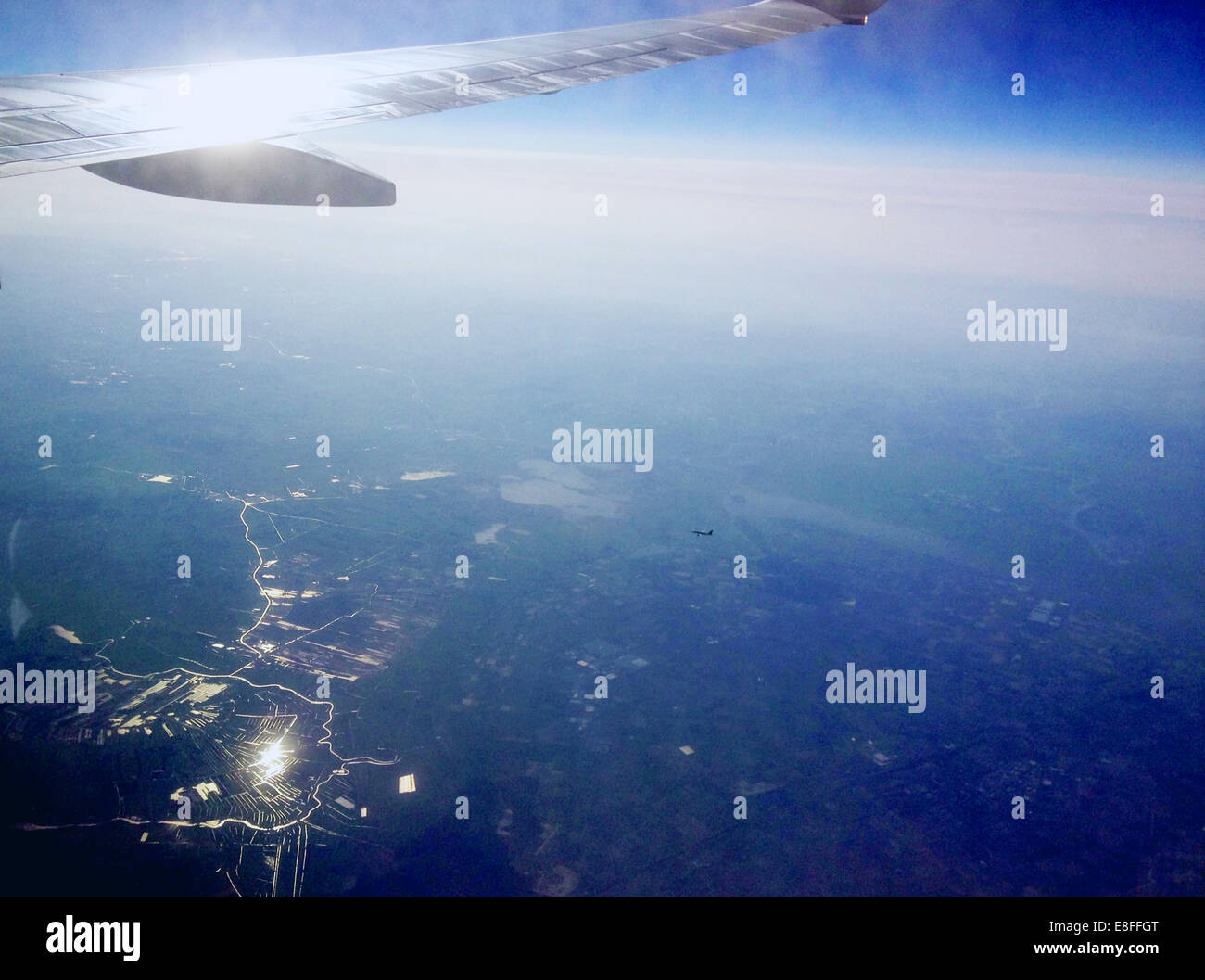 View of airplane wing from vehicle interior/airplane window Stock Photo