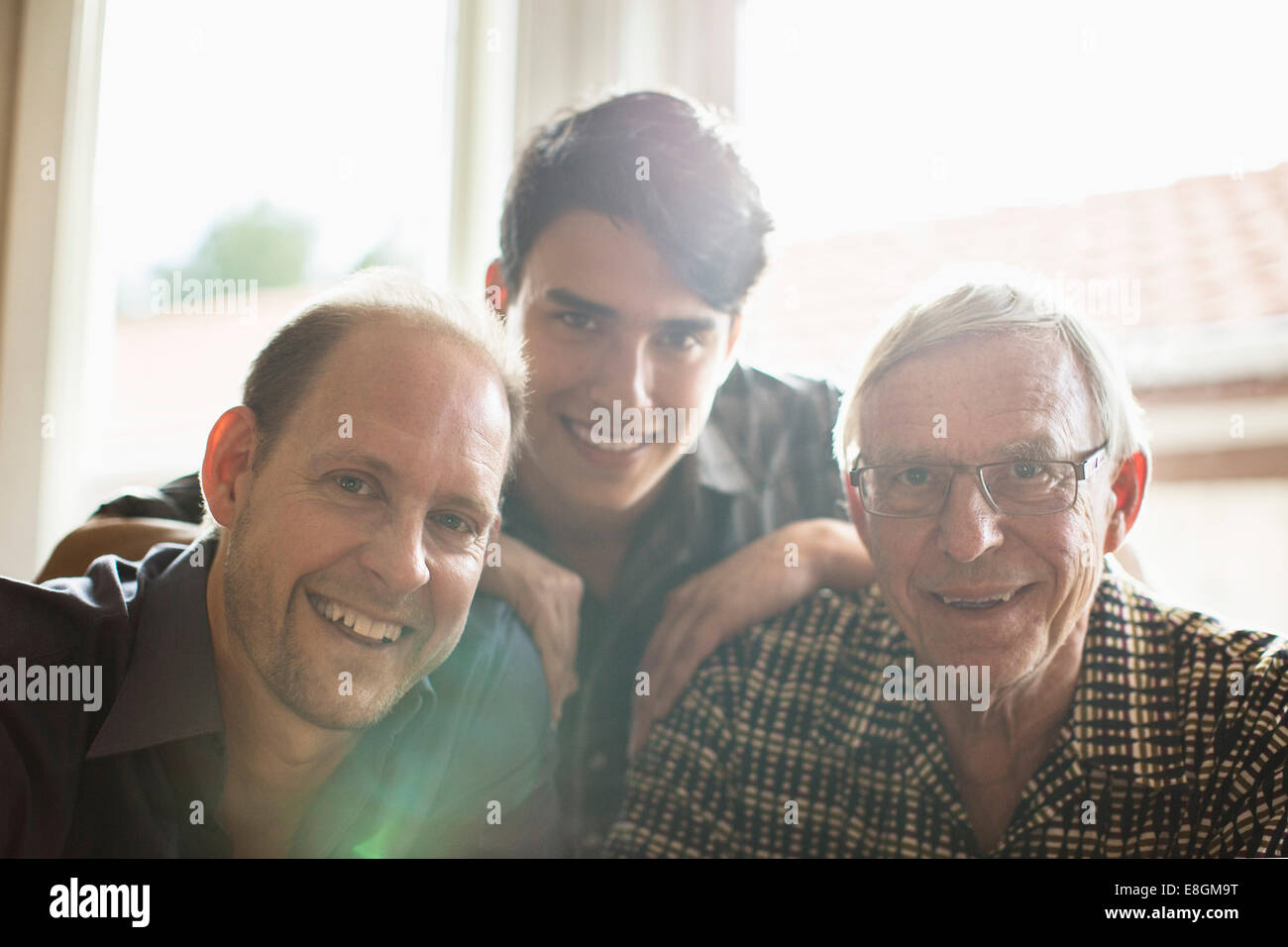 Portrait of three generation family smiling together at home Stock Foto