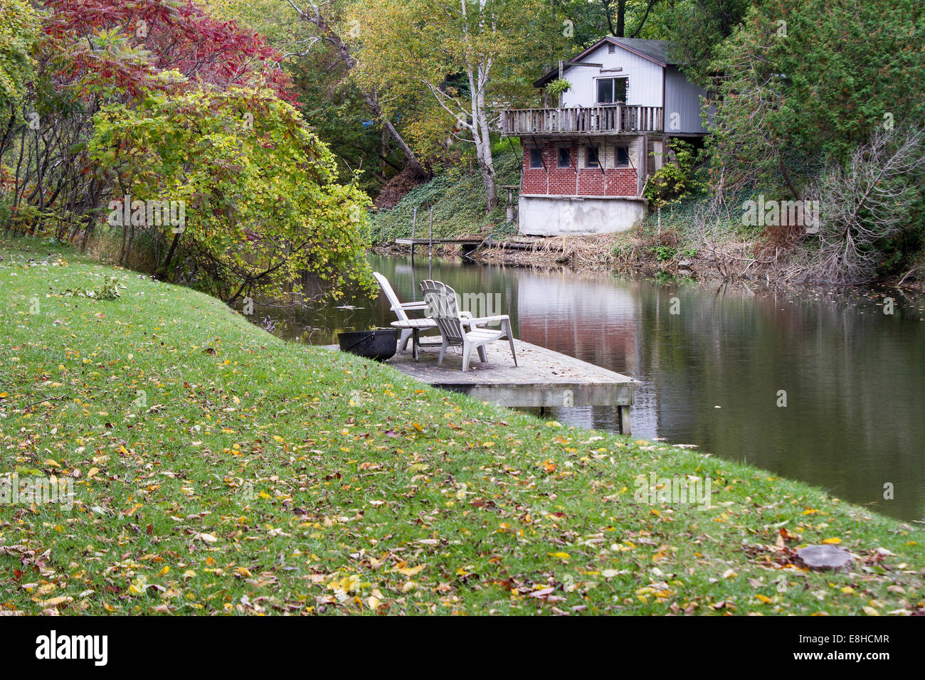 two-empty-adirondack-chairs-sit-looking-