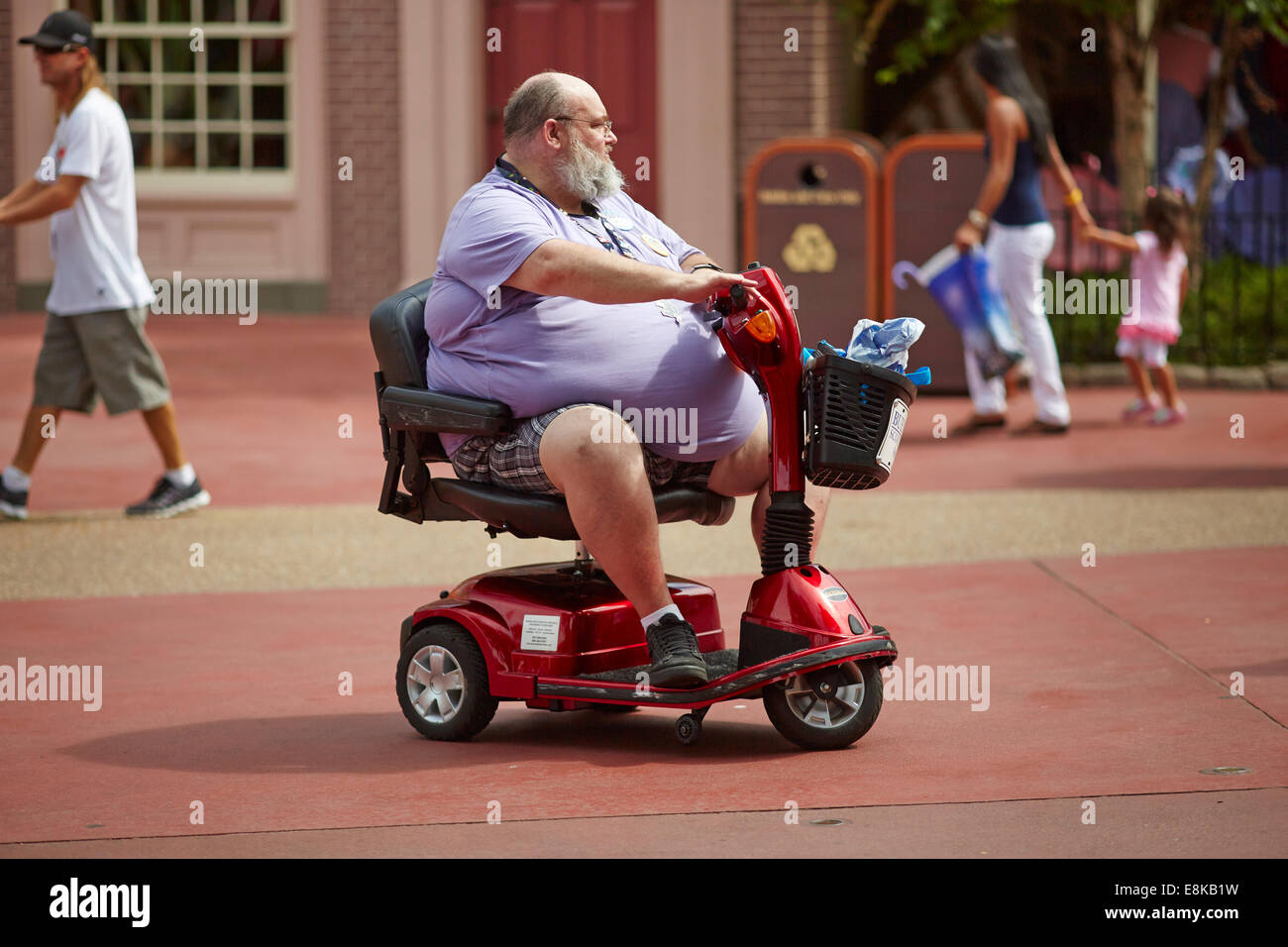 Florida Usa Disneyland Fat Person On A Mobility Scooter