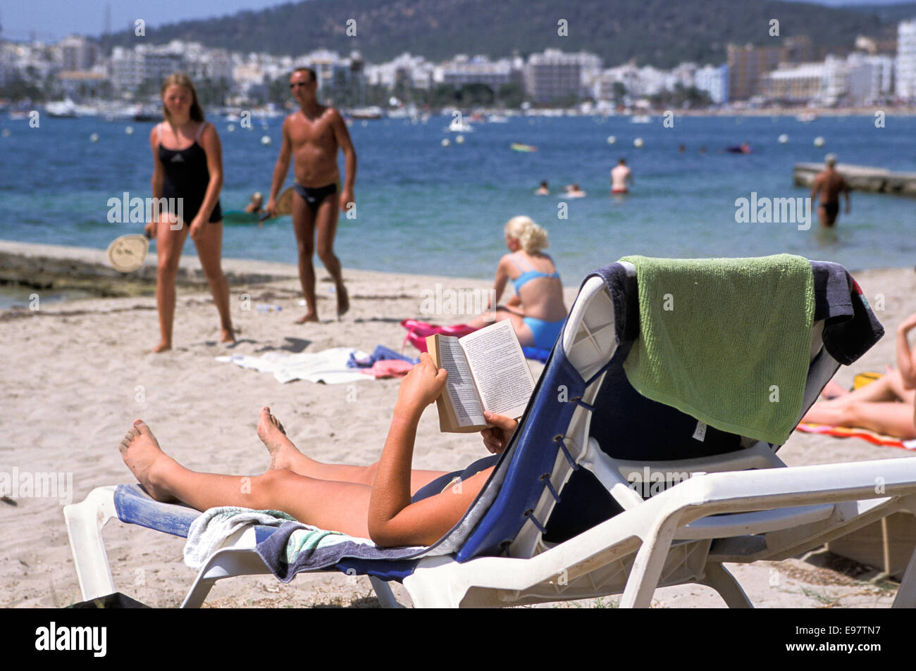 Sunbathing on the beach, San Antonio, Ibiza, Spain Stock Photo