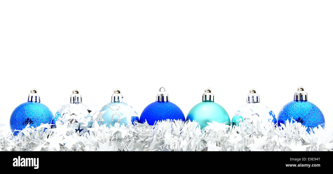 Blue christmas bauble border with garland over a white