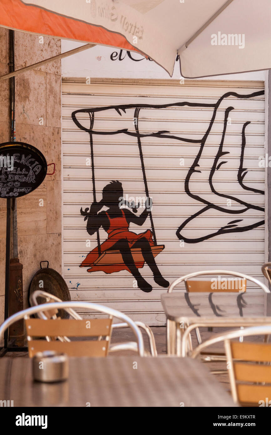 girl-swinging-from-a-finger-graffiti-in-
