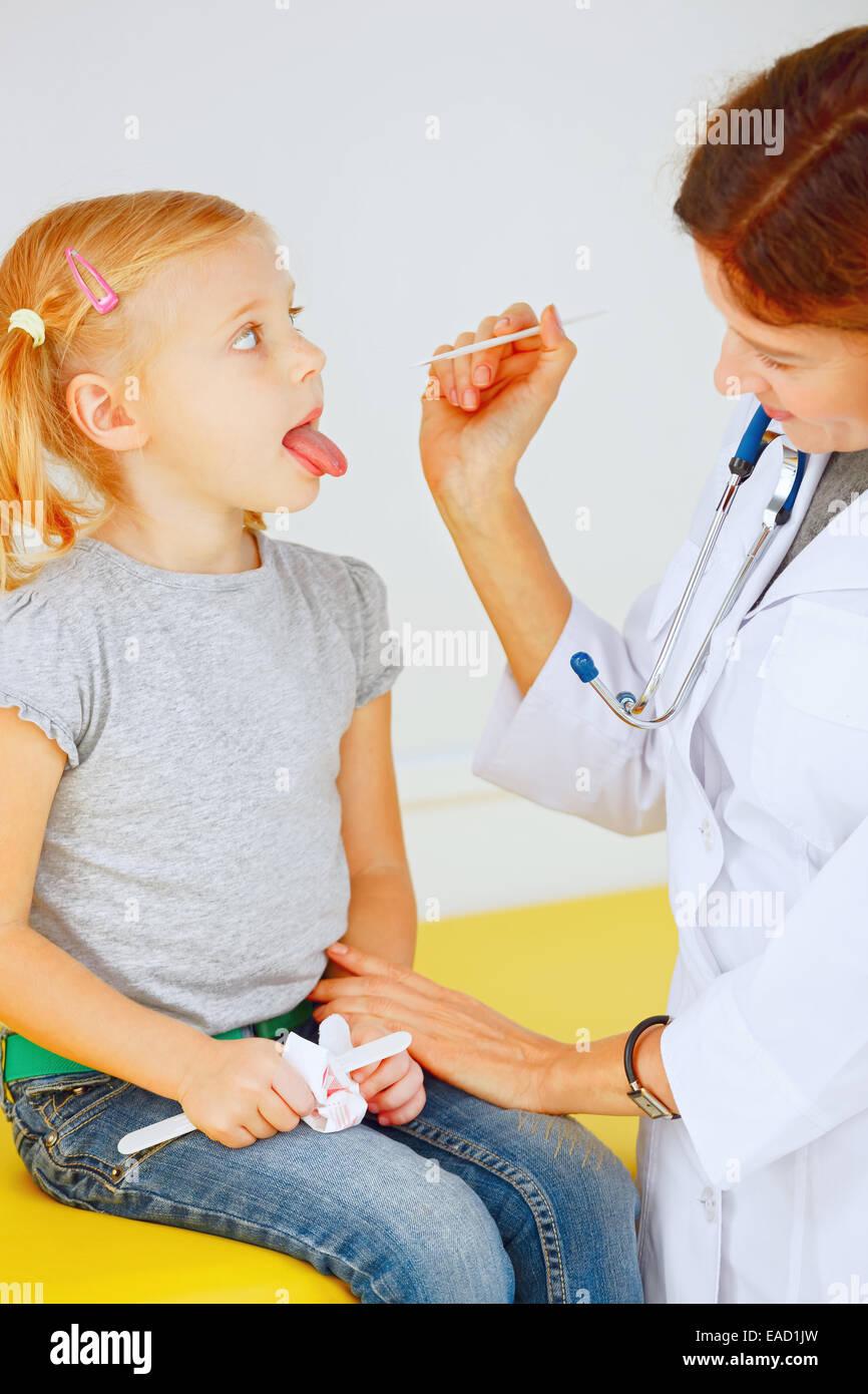 Doctor examining a young girls abdomen Stock Photo - Alamy