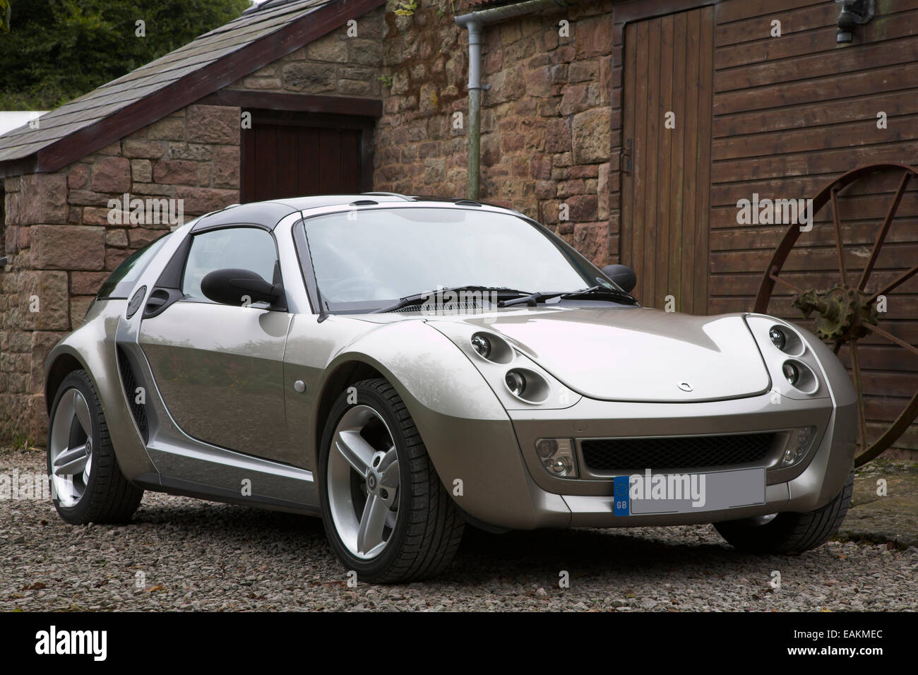 gold coloured smart roadster coupe car stock photo royalty free image 75421204 alamy. Black Bedroom Furniture Sets. Home Design Ideas