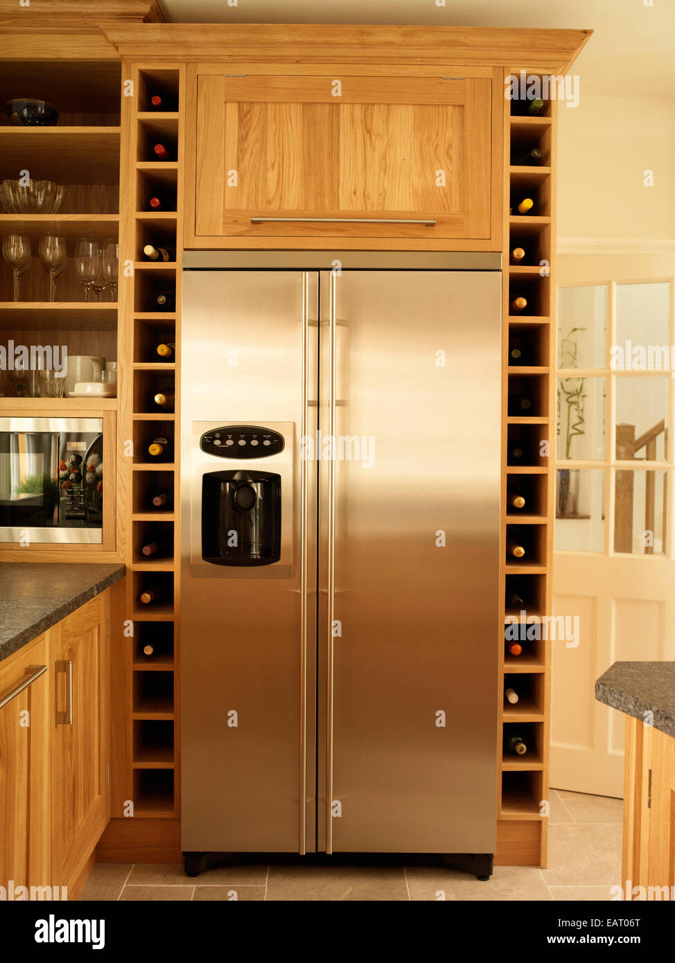 Stainless Steel Fridge And Built In Wine Rack Storage In