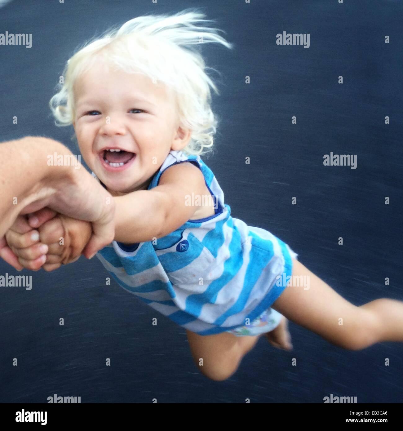 Toddler being spun around Stock Foto