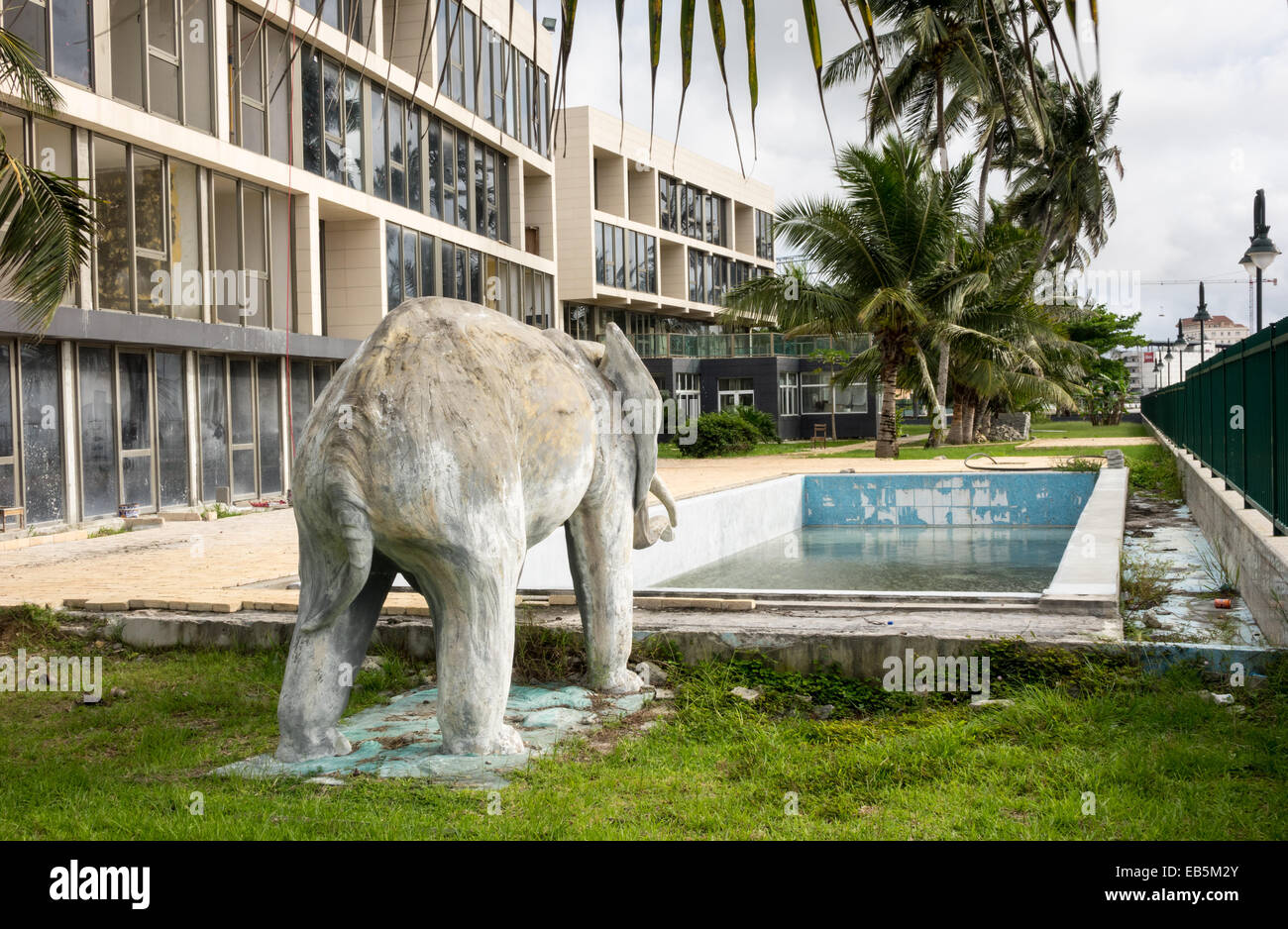 Elephant statue and unfinished swimming pool in garden of for Garden elephant pool
