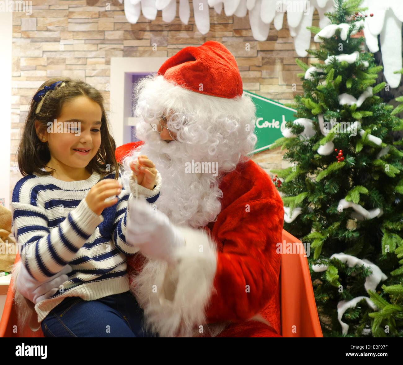 santa-claus-at-shopping-mall-with-girl-o