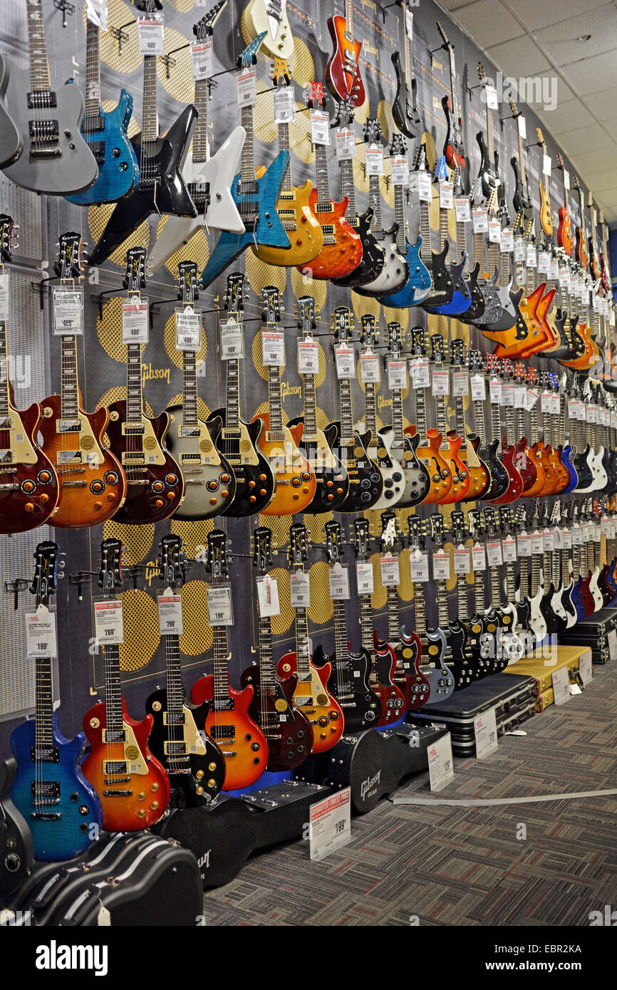 new epiphone fender gibson guitars for sale at the guitar center stock photo royalty free. Black Bedroom Furniture Sets. Home Design Ideas