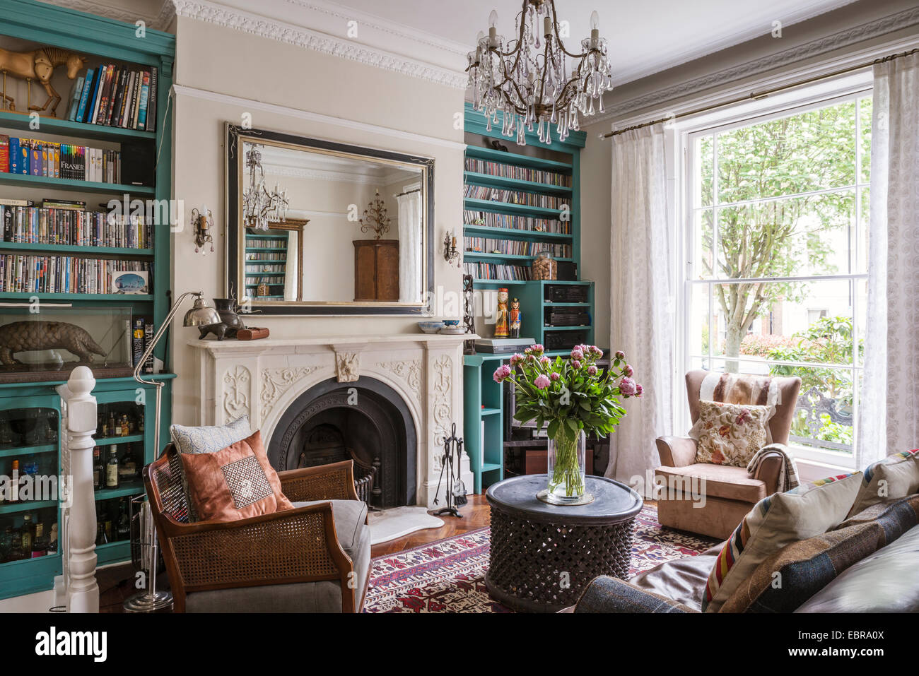 Turquoise Shelving In Elegant Living Room With Marble Fireplace And Stock Photo Royalty Free
