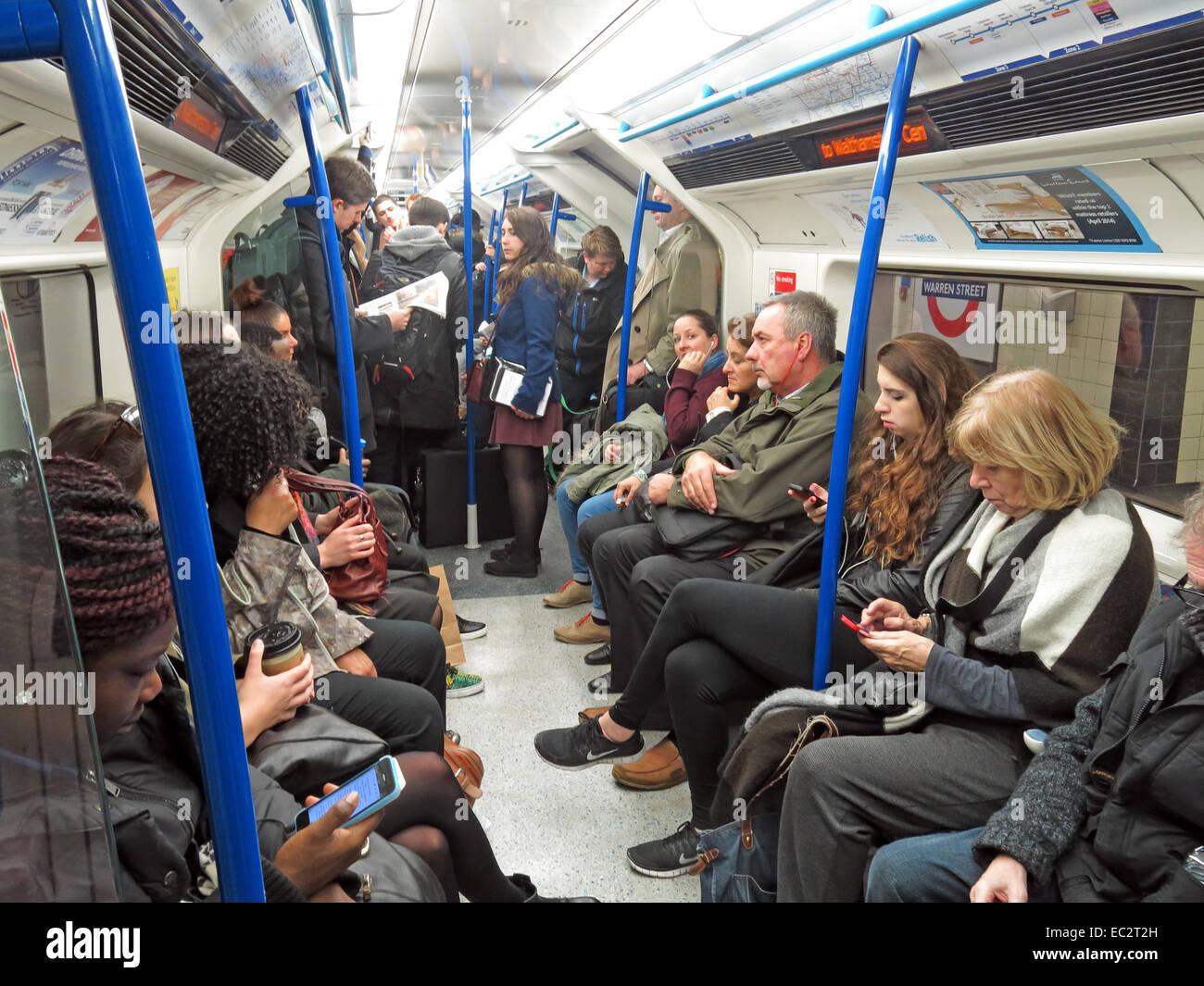 Busy Victoria Tube line train in London Underground Stock Photo