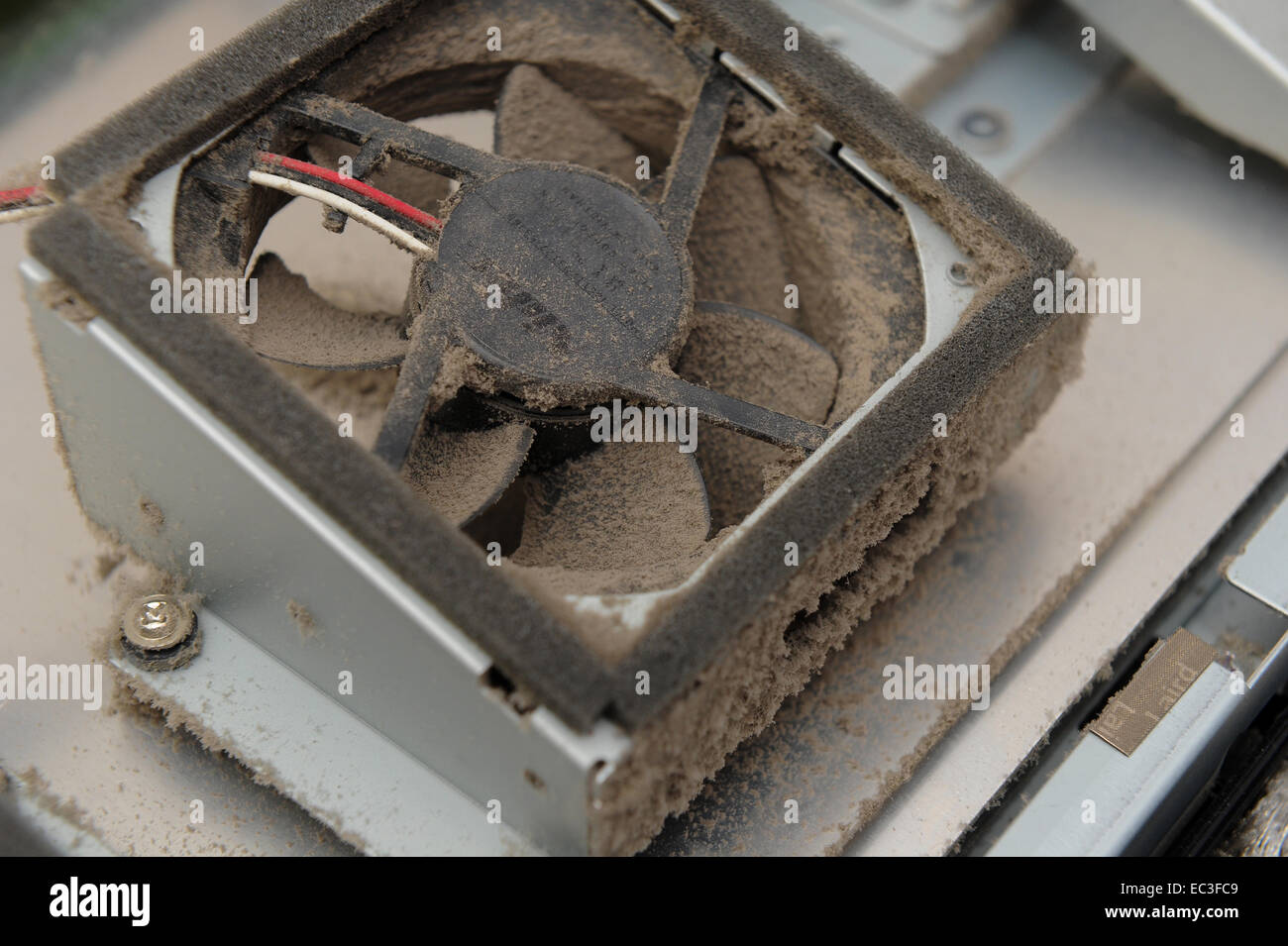 Cooling Fans For Electronic Equipment : Dust accumulation inside electronic equipment showing
