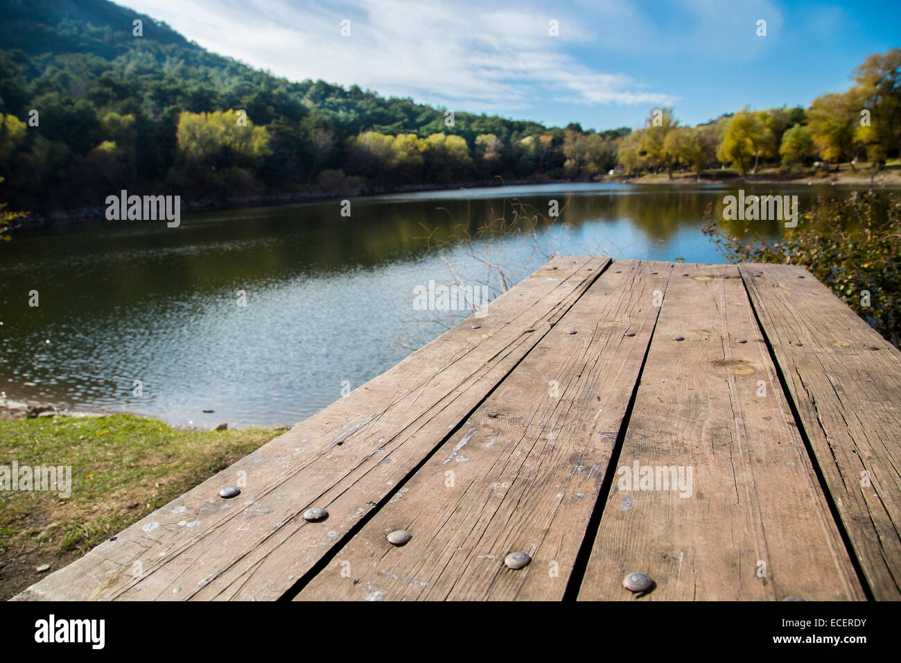 Perspective Of Wooden Picnic Table With Blur Landscape