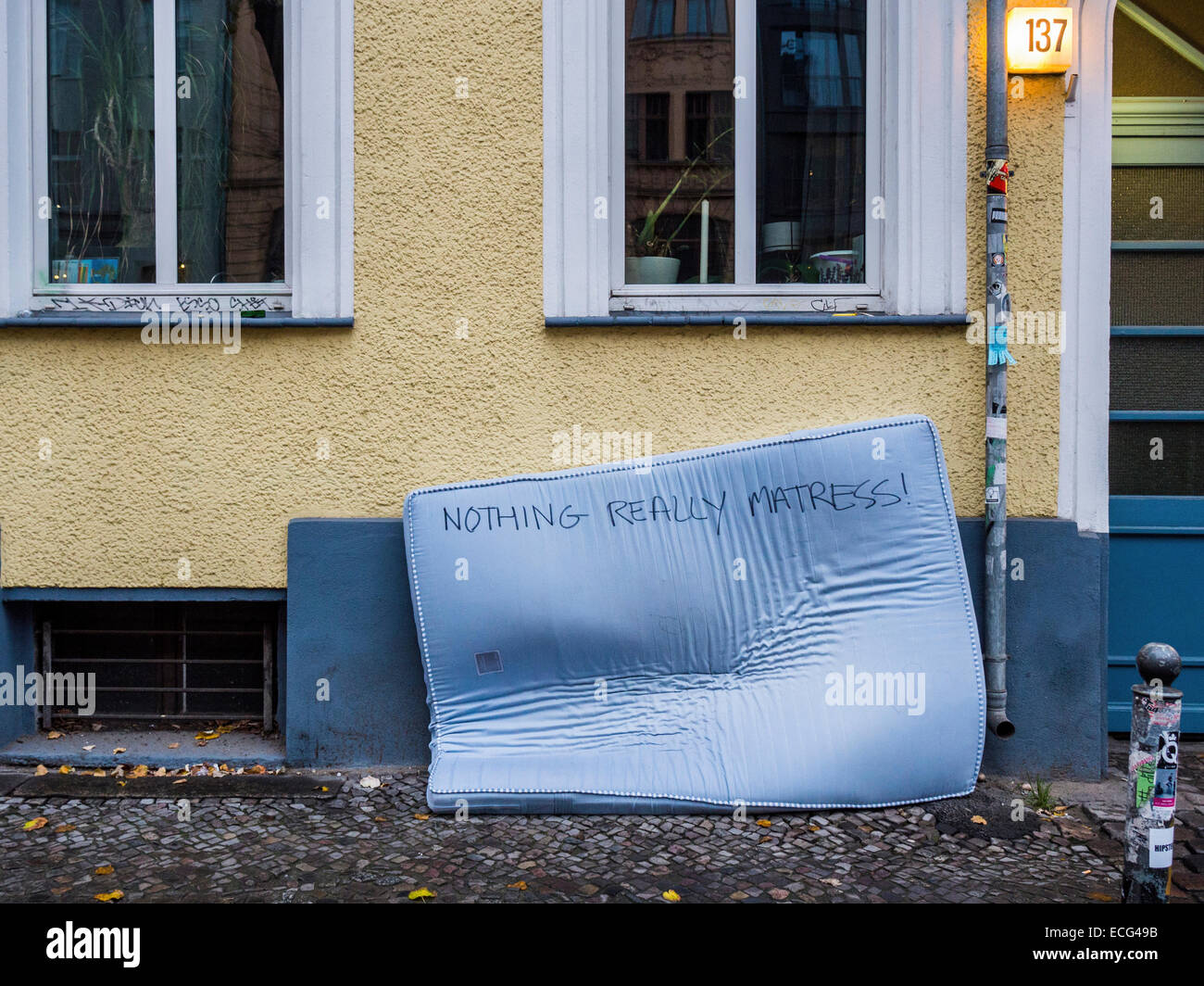 mattress-dumped-outside-house-on-a-pavem