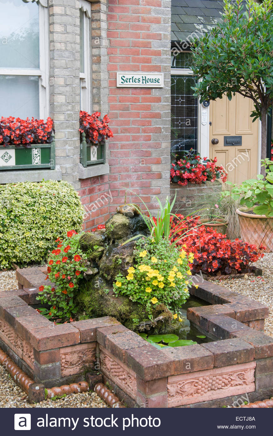 front garden of victorian terraced house features a