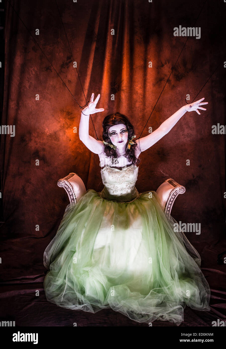 Fantasy makeover photography: A young woman girl model made up to look like a porcelain white-faced painted puppet Stock Foto