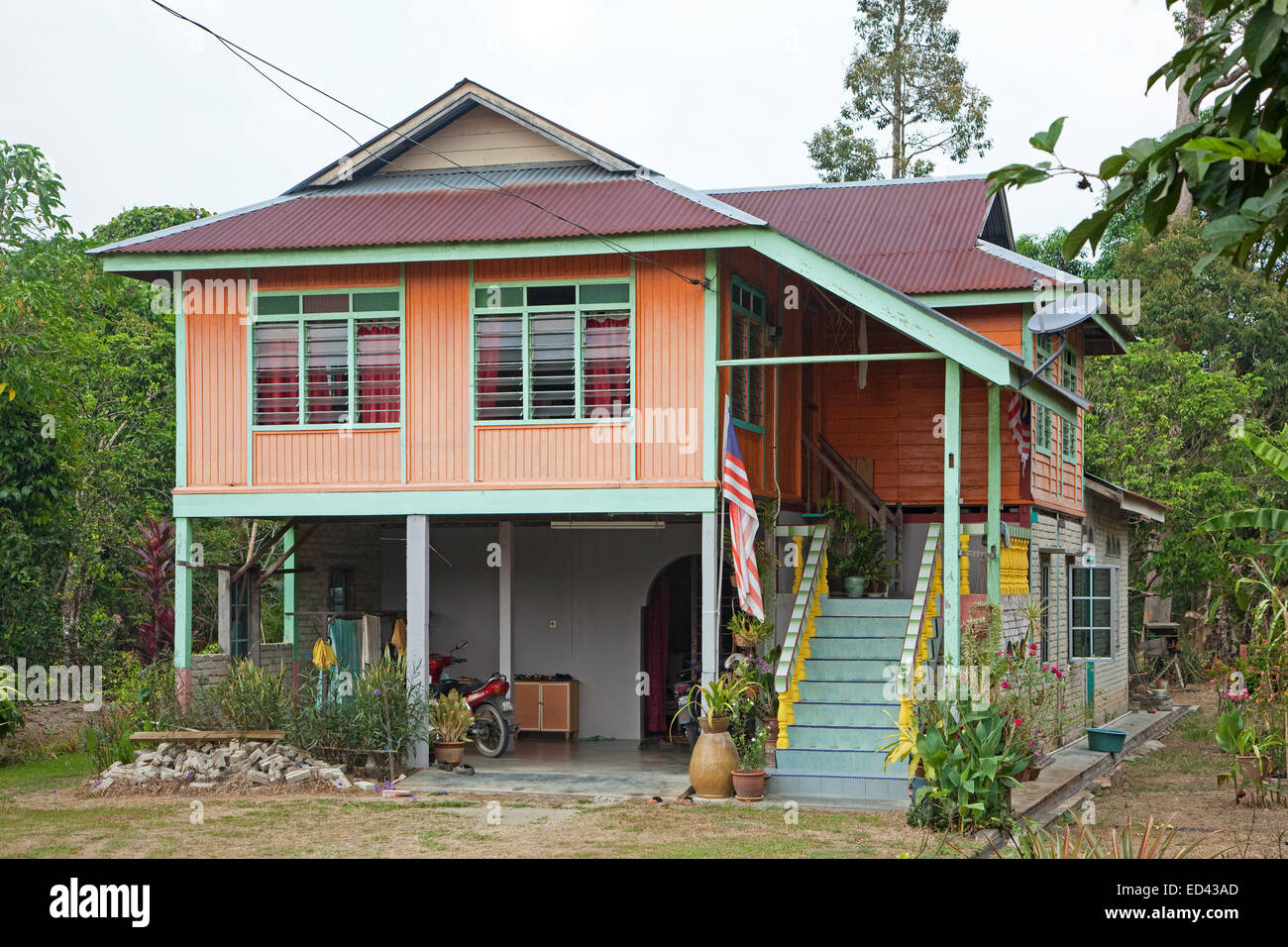 Modern Malaysian Wooden House On Pillars In The