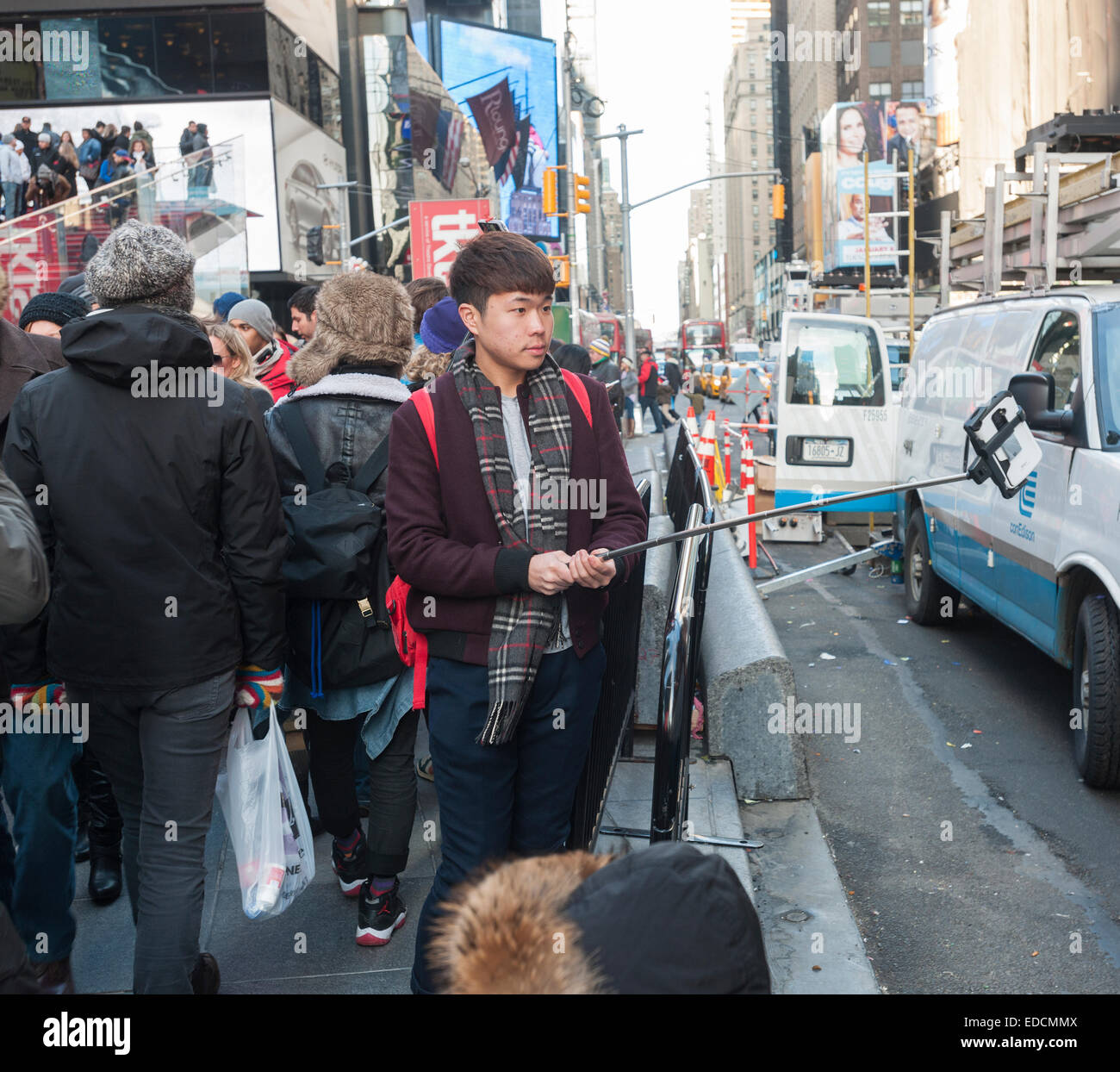 tourists in times square in new york use their selfie sticks to take stock photo royalty free. Black Bedroom Furniture Sets. Home Design Ideas