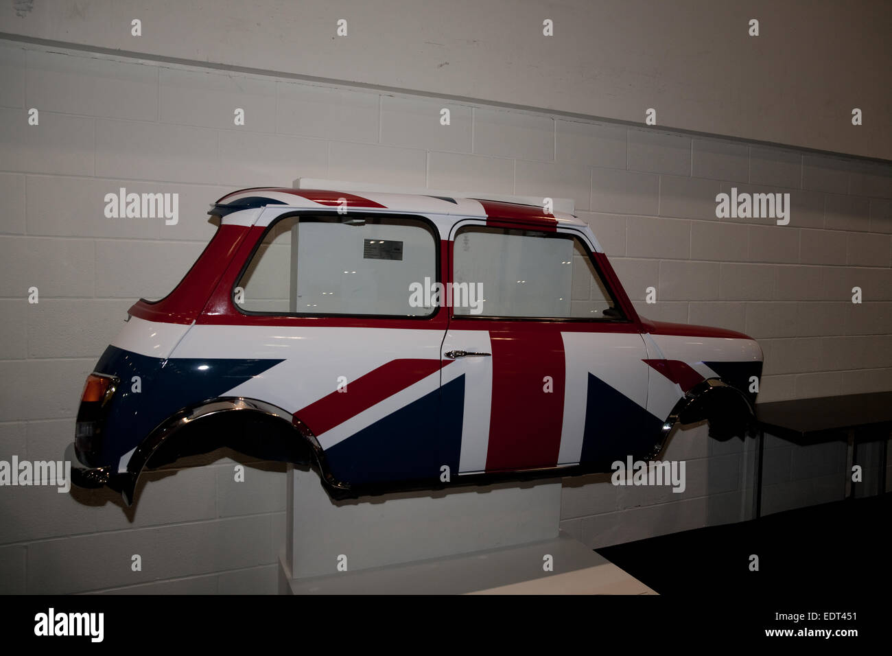 Half A Mini Mounted On A Wall At The London Classic Car