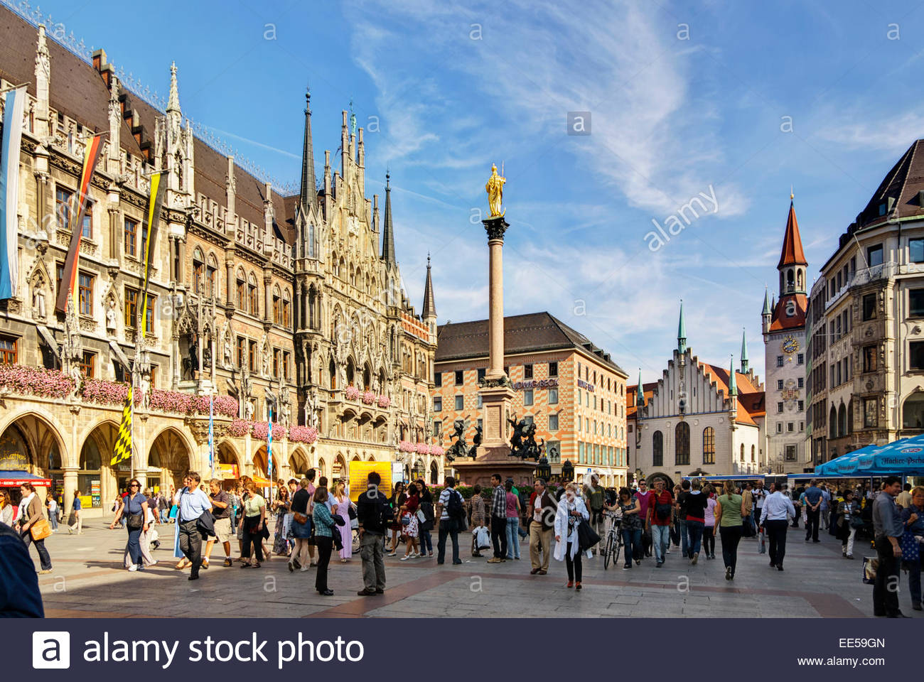 Tourists and others walk, shop, eat and drink on the Marienplatz, the central town square in München / Munich, Germany. Stock Photo