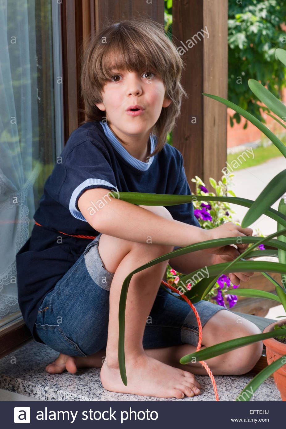Seven Year Old Boy Child Age 7 Years Portrait Playing