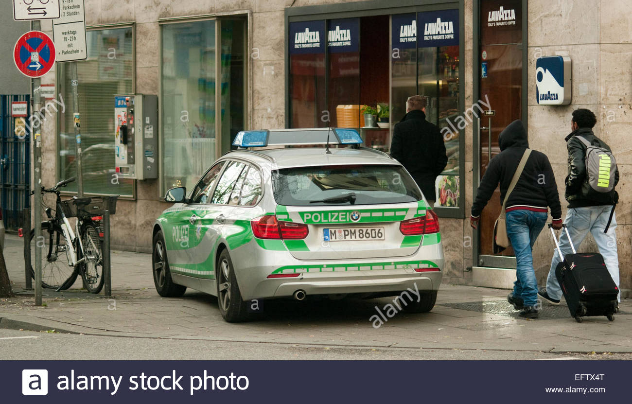 police car parked on pavement outside coffee shop munich bavaria stock photo royalty free image. Black Bedroom Furniture Sets. Home Design Ideas