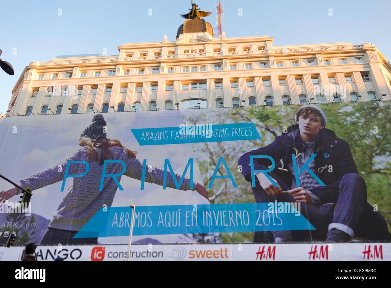 building-paris-madrid-with-huge-advertis