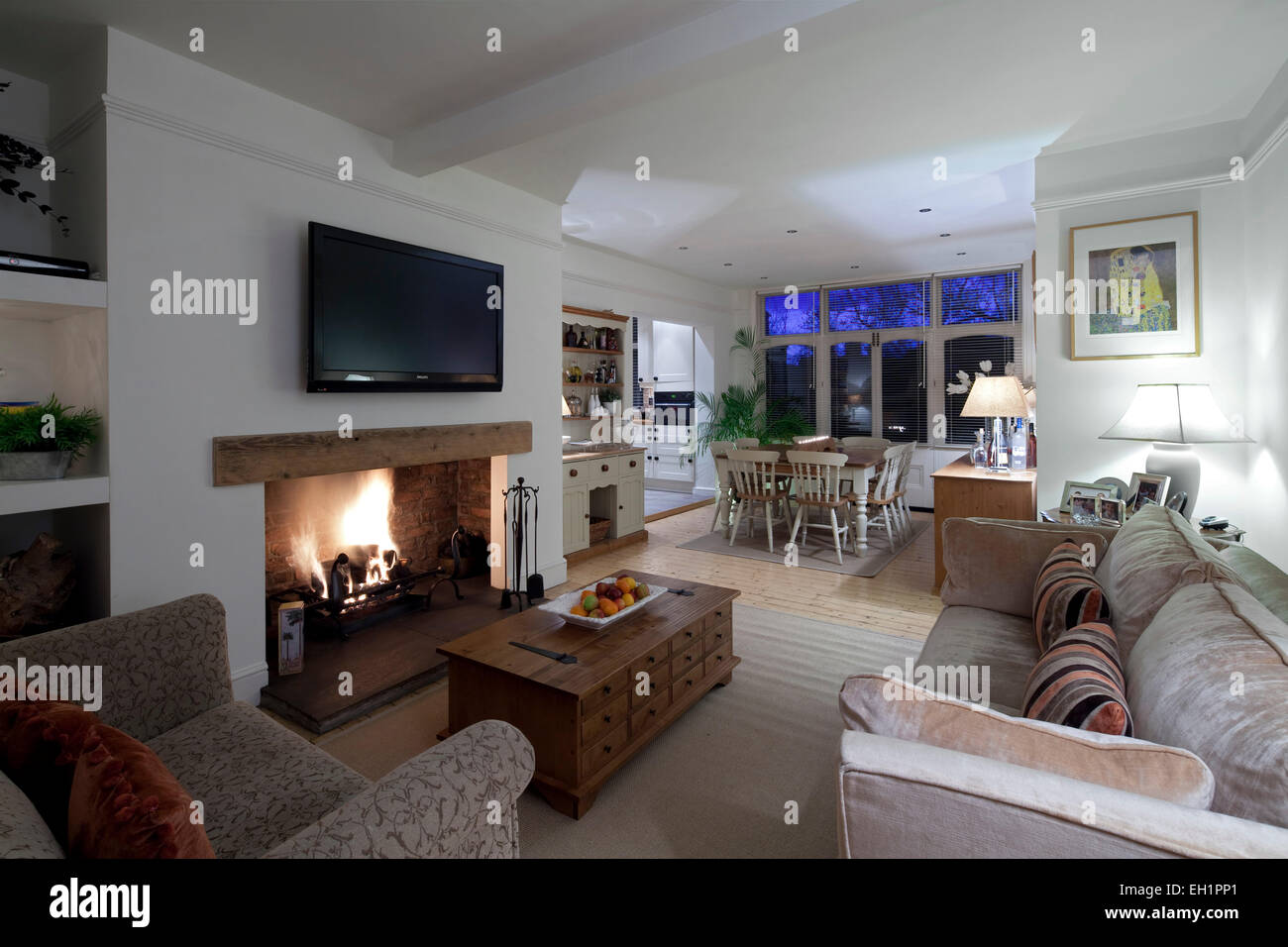 Open plan living and dining room with plasma screen above - Living room dining room with fireplace ...