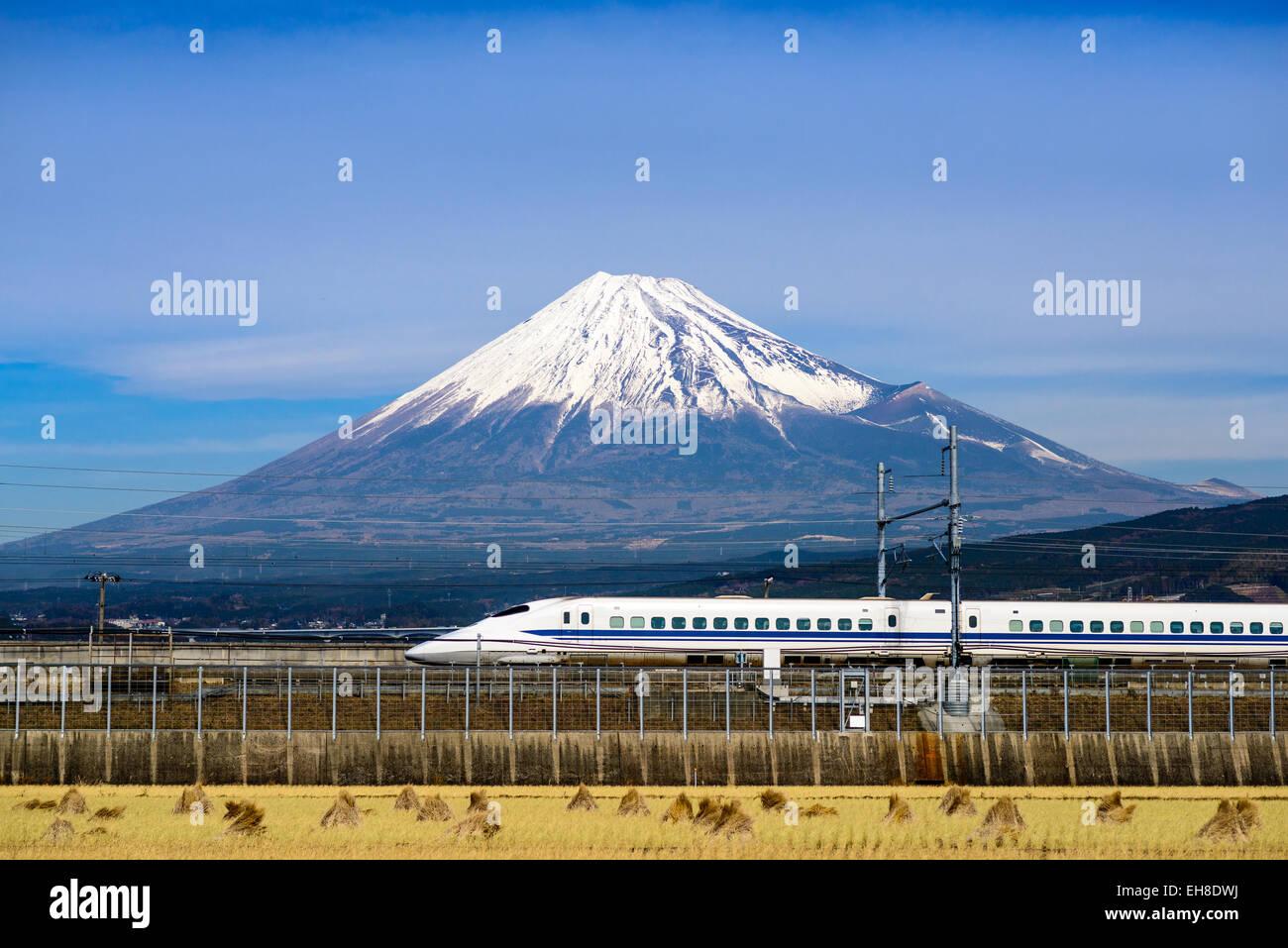 a-bullet-train-passes-below-mt-fuji-in-j