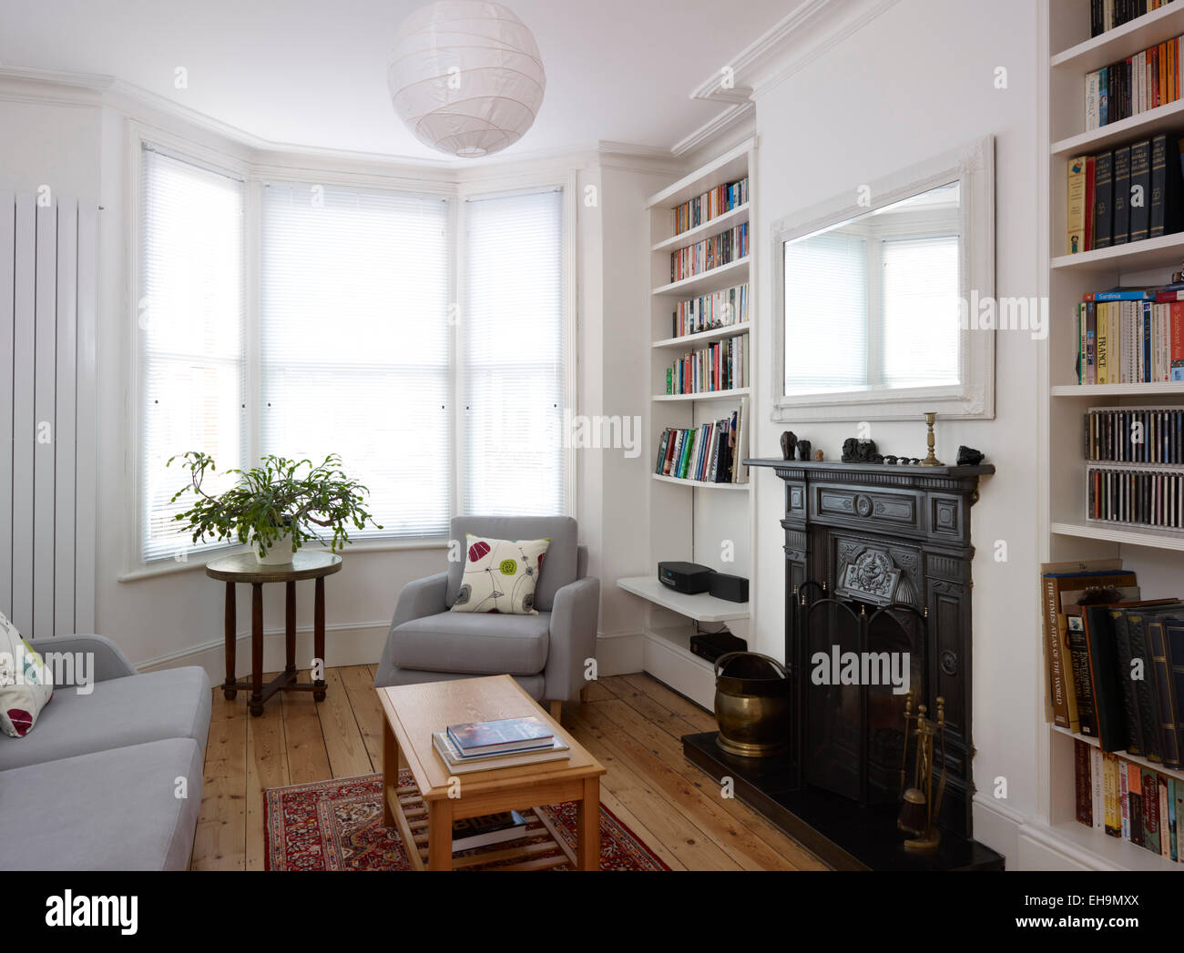 Sitting Room With Bay Window And Fireplace Residential