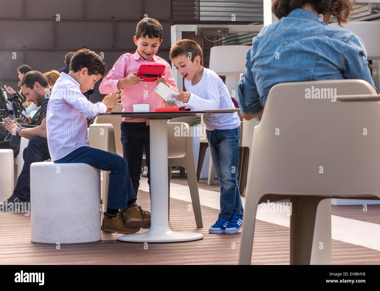 children-playing-handheld-computer-games
