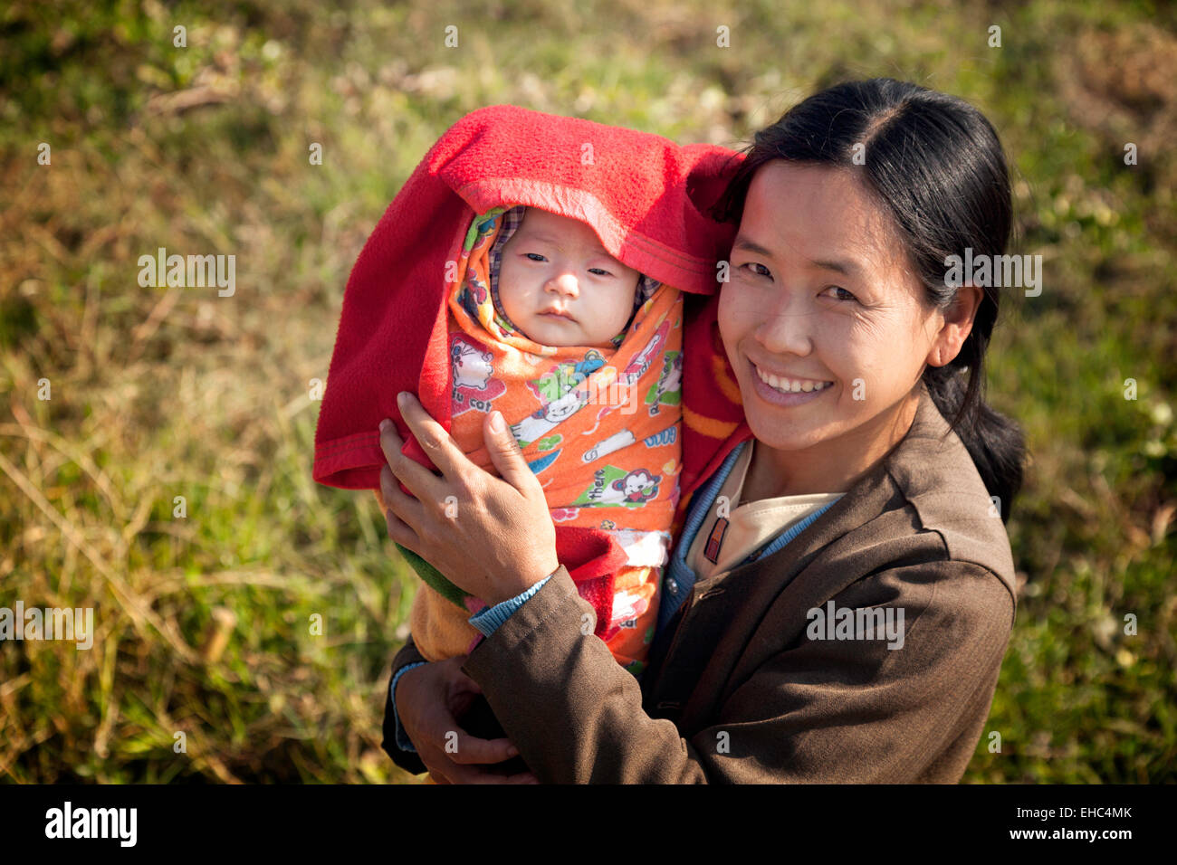 a-burmese-mother-with-her-baby-child-mya