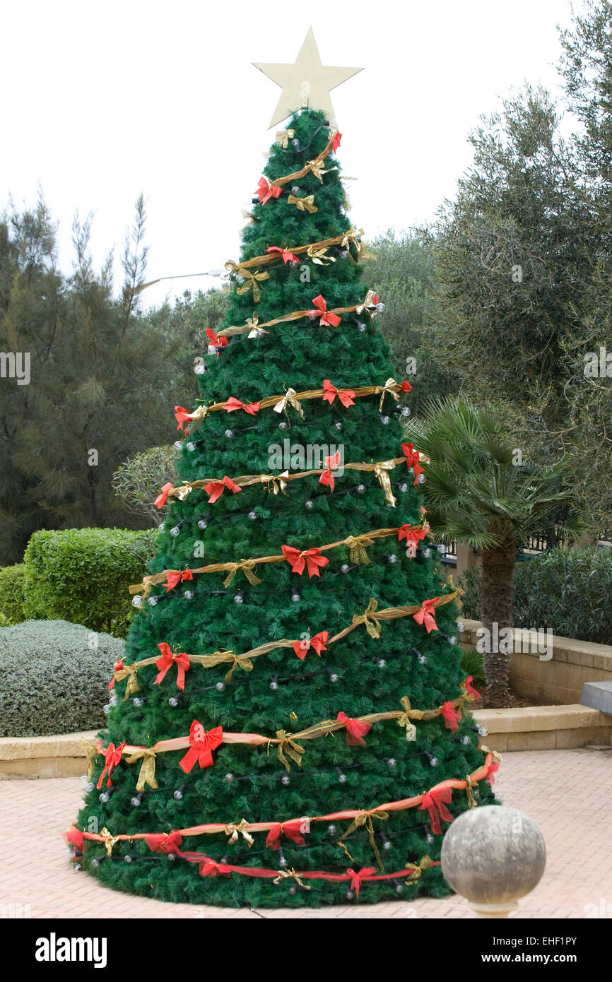 Real Christmas Tree Decorated With Red Bows And Fairy