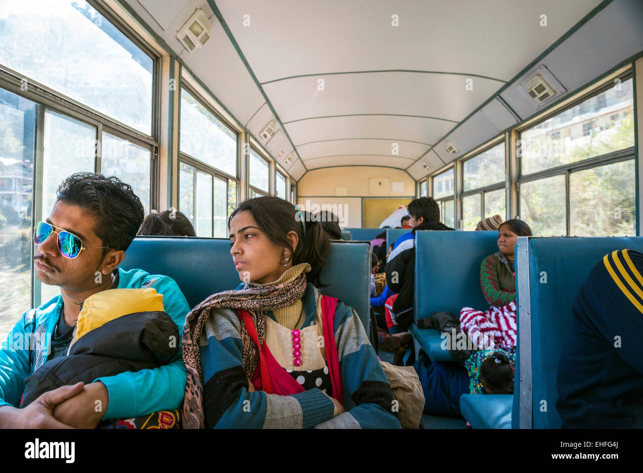 A young Indian couple and child on the Kalka-Shimla Railway, Himachal Pradesh, India Stock Foto
