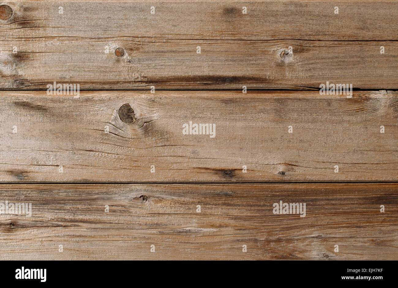 Sun bleached weathered cedar siding wall with knots and