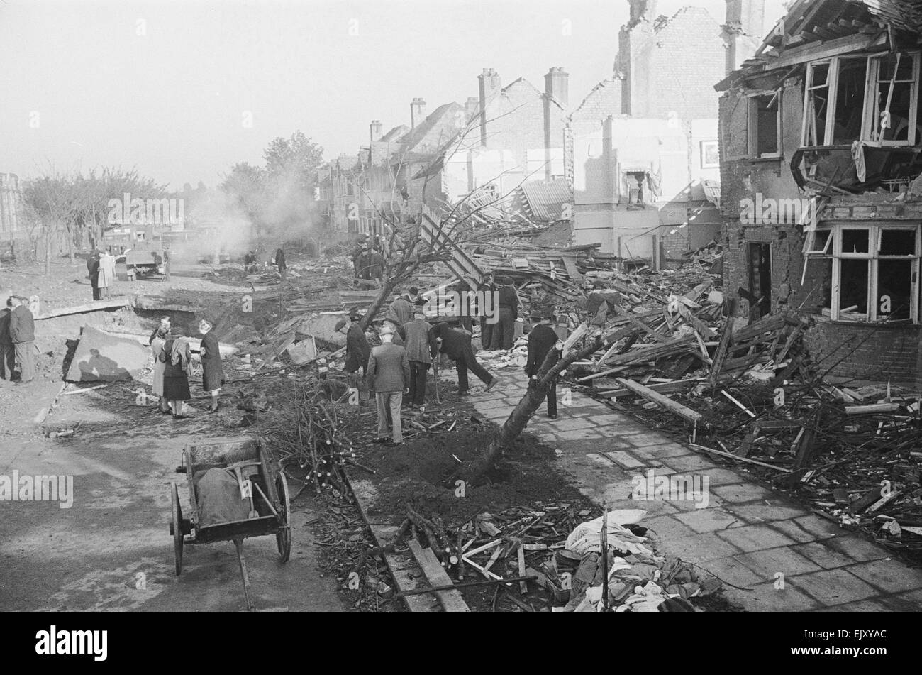 The aftermath of  V2 explosion. On the 8th September 1944 a huge explosion occured in Staveley Road, Chiswick, West London. There had been no siren, no warning and no V1 flying bombs had been sighted.  The explosion was caused by the first V2 ballistic missile fired in anger. Hitler's much vaunted A4 Rocket more commonly known as the V2 weighed 13 tons and had arrived via the stratosphere at 3,000 miles an hour faster than the speed of sound. This meant that the first anybody knew about the attack was the explosion followed by the roar of the rocket motors catching up