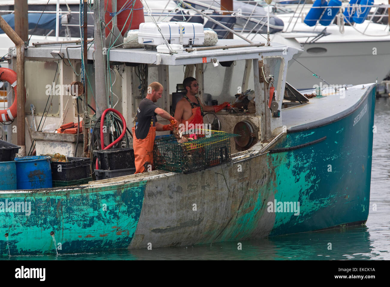 Maine lobster fishermen on lobster fishing boat stock for Lobster fishing in maine