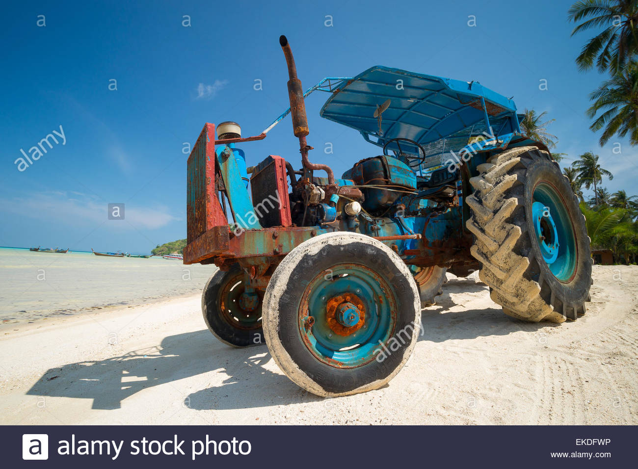 blue-tractor-on-a-beach-used-to-carry-pe