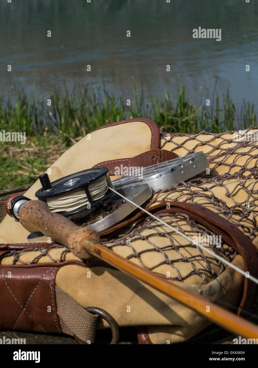 Traditional old vintage fly fishing tackle with the river for How to get free fishing gear