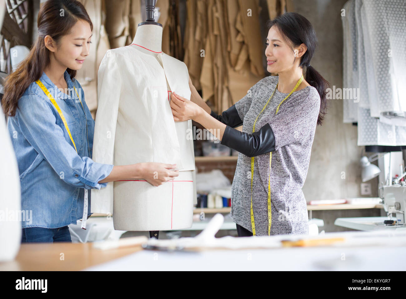 Two female fashion designers working in studio Stock Photo ...