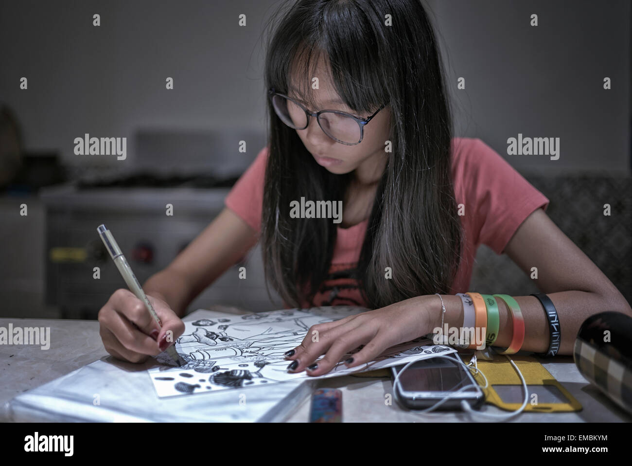teenage-girl-drawing-at-home-EMBKYM.jpg