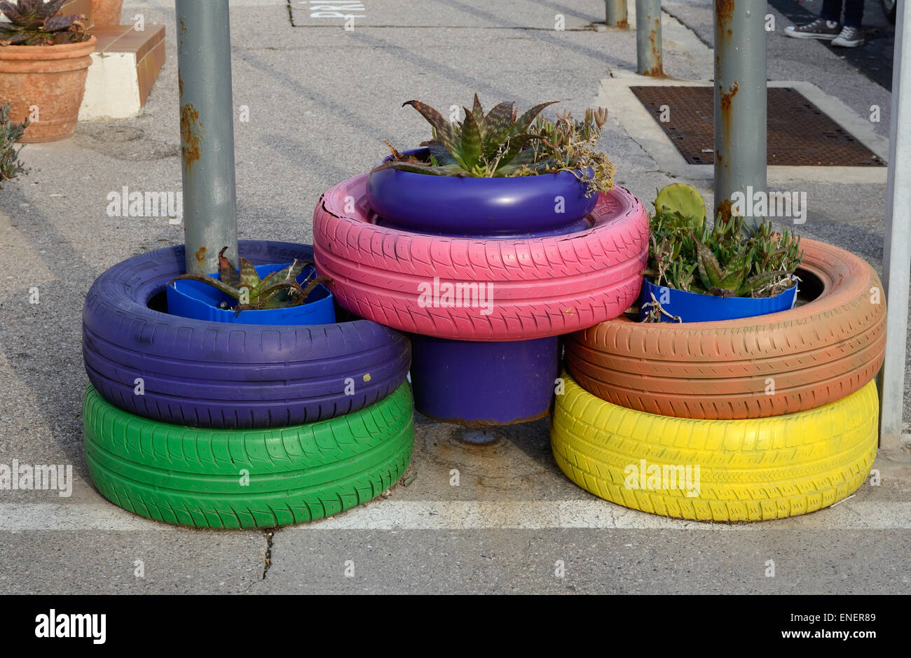 garden planters recycled with Stock Photo Painted Tires Or Tyre Planters Or Colorful Rubber Plant Pots 82074841 on Ingenious Ways To Recycle Glass Bottles additionally Retriever 24 Inch Weathervane in addition Stock Photo Painted Tires Or Tyre Planters Or Colorful Rubber Plant Pots 82074841 together with 10 Creative Flower Garden Crafts Made Reyccled Materials likewise 40 Unique Fun Container Garden Ideas 2.